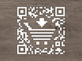Concept QR code label with a shopping cart Royalty Free Stock Photos