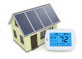Concept of renewable energy one digital programmable thermostat with a house and solar panel d render Stock Photography