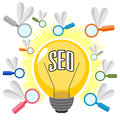 Concept of search optimization shining bulb and icons as seo Royalty Free Stock Photography