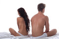 Concept of sexual disorders among partners upset young couple sitting apart in bed Royalty Free Stock Photo