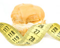 Concept of slimming caramel cake with measuring tape on white background Stock Photography