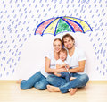 Concept social protection of family family took refuge from miseries and rain under umbrella the the the an Stock Photos