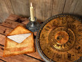 concept still life with zodiac sighs, candle and letter Royalty Free Stock Photo