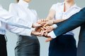 Concept of teamwork business people joined hands Stock Photos