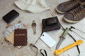 Concept turism items include an old photo camera passport wallet with currency hat and smartphone Royalty Free Stock Photo