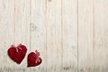 Concept Of Valentine's Day. Wicker hearts on wooden background w