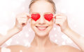 Concept of valentine s day woman with a red heart on eyes beautiful Stock Images