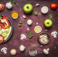 Concept of vegetarian food preparation of salad various vegetables and fruits pan rustic wooden background top view close up