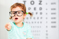 Concept vision testing. child  girl with eyeglasses Royalty Free Stock Photo