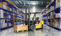 Concept of warehouse The forklift in the big warehouse delivery