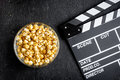 Concept of watching movies with popcorn top view dark background Royalty Free Stock Photo