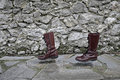 Concept way of life walking boots alone future old on the road Royalty Free Stock Photo