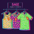 Conceptual art about clearance and summer sale with big discounts and offers. Drawing og ugly shirts with floral neon print Royalty Free Stock Photo