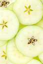 Conceptual background pattern and texture of sliced apples Royalty Free Stock Photo