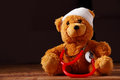 Conceptual Bandaged Teddy Bear with Stethoscope Royalty Free Stock Photo