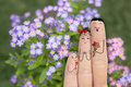 Conceptual family finger art. Father and son are giving flowers his mother. Stock Image. Royalty Free Stock Photo