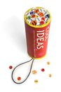 Conceptual firework unit with ideas confetti. Royalty Free Stock Photography