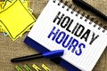 Conceptual hand writing showing Holiday Hours. Business photo showcasing Celebration Time Seasonal Midnight Sales Extra-Time Openi Royalty Free Stock Photo