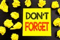 Conceptual hand writing text showing Do Not Forget. Business concept for Don t memory Remider written on sticky note paper. Folded Royalty Free Stock Photo