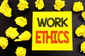 Conceptual hand writing text showing Work Ethics. Business concept for Moral Benefit Principles written on sticky note paper. Fold Royalty Free Stock Photo