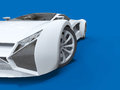Conceptual high-speed white sports car. Blue uniform background. Glare and softer shadows. 3d rendering. Royalty Free Stock Photo
