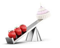 Conceptual image of healthy eating. Cake and apples on the scale Royalty Free Stock Photo