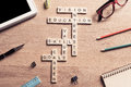 Conceptual keywords on wooden table with elements of game making crossword