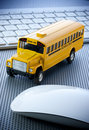 Conceptual learning technology image yellow school bus computer keyboard white background Royalty Free Stock Images
