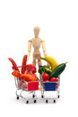 Conceptual man meat vegetables isolated on white symbol holding two shopping carts one is full with and one with standing side by Stock Photos