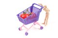 Conceptual photo with miniature shopping-cart Royalty Free Stock Photography