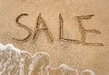 Conceptual photo of summer sale written on sandy beach Royalty Free Stock Photo