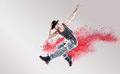 Conceptual picture of hip hop dancer among red dust Royalty Free Stock Photo