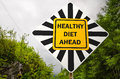 Conceptual road sign about healty diet healthy ahead creative Royalty Free Stock Photo