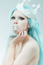 Conceptual studio portrait of woman with cyan hair Royalty Free Stock Image