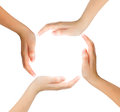 Conceptual symbol of multiracial human hands making a circle on white background Royalty Free Stock Photography