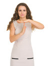 Concern young woman showing stop gesture Royalty Free Stock Photo
