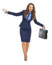 Concerned business woman balancing on dangerous path with briefcase and cell phone Royalty Free Stock Images