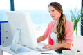concerned business woman on her computer Royalty Free Stock Photo