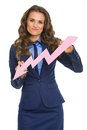 Concerned business woman showing graph arrow going down isolated on white Royalty Free Stock Photo