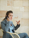 Concerned business woman speaking mobile phone Royalty Free Stock Photo