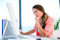 concerned businessWoman staring worriedly at a computer Royalty Free Stock Photo