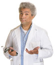 Concerned doctor hispanic with stethoscope and palms up Stock Photo