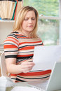 Concerned Pregnant Woman Working In Home Office Royalty Free Stock Photo