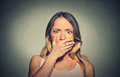 Concerned scared shocked woman covering her mouth closeup Stock Photo
