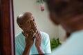 Concerned senior man looking at mirror Royalty Free Stock Photo