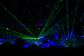 Concert bright laser show in the crowd of merry men Stock Photography