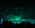 Concert bright laser show in the crowd of merry men Royalty Free Stock Images