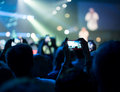 Concert close up of photographing with smartphone during a Stock Image