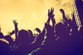 Concert, disco party. People with hands up in night club. Royalty Free Stock Photo