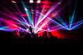 Concert performances bright laser show in the crowd of merry men Royalty Free Stock Photography